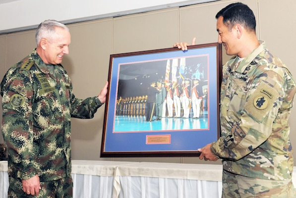 Maj. Gen. K.K. Chinn (right), U.S. Army South commander, presents a framed photo to Gen. Alberto Jose Mejia, Colombian army commander, during the closing ceremony of the 2016 U.S.-Colombia Bilateral Army Staff Talks Executive Meeting in Bogota, Colombia April 14. The framed photo is significant since it was taken when Mejia was in Washington, D.C., last February for the Conference of the American Armies transfer ceremony where U.S. Army Chief of Staff Gen. Mark A. Milley presented him with the Legion of Merit.