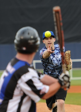 "Tyler Bouldin, WLOX reporter and ""Boots"" team member, pitches a softball to Tony DeRosa, Special Olympics athlete, during the ""Boots versus Badges"" softball game at the Biloxi Shuckers MGM Park April 21, 2016, Biloxi, Miss. The game was the kickoff event for the 2016 Special Olympics Mississippi Summer Games, which will be hosted by Keesler Air Force Base, Miss., May 20-21.  (U.S. Air Force photo by Kemberly Groue)"