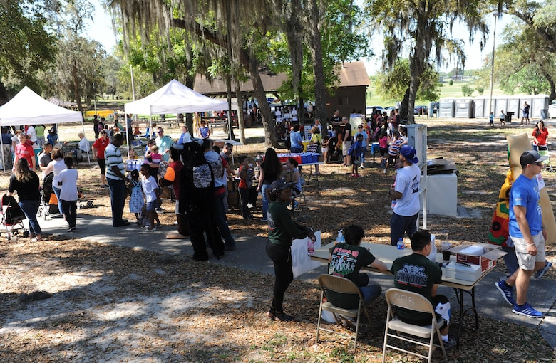 Keesler families attend Child Pride Day at marina park April 23, 2016, Keesler Air Force Base, Miss. Keesler families attended the annual event which featured activities, demonstrations and information on programs focused on care of military families. Child Pride Day was held in conjunction with the month of the military child. (U.S. Air Force photo by Kemberly Groue)