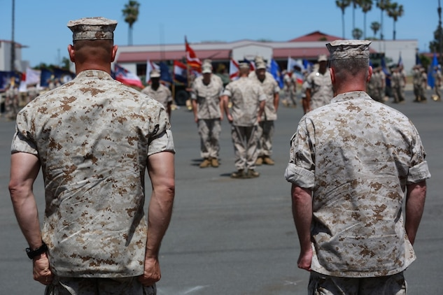 MARINE CORPS BASE, CAMP PENDLETON,Calif. – Col. Vance L. Cryer (left) the out-going commanding officer for the 15th Marine Expeditionary Unit, and Col. James P. Fallon, the unit's oncoming commanding officer, stand ready to salute Marines during a pass in review during a change of command ceremony on Camp Pendleton April 22, 2016. During the ceremony Cryer relinquished command of the unit to Fallon who previously was the MEU's executive officer. (Marine Corps photo by Cpl. Jonathan Boynes/Released)