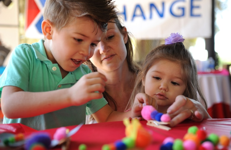 Capt. Sarah Sousa, 81st Inpatient Operation Squadron nurse, assists her kids, Jameson and Brooke, with making a clothes pin caterpillar during Child Pride Day at marina park April 23, 2016, Keesler Air Force Base, Miss. Keesler families attended the annual event which featured activities, demonstrations and information on programs focused on care of military families. Child Pride Day was held in conjunction with the month of the military child. (U.S. Air Force photo by Kemberly Groue)