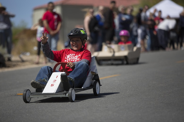 Frank D. Hernandez, 9, son of Staff Sgt. Frank Hernandez, instructor, Communication Training Battalion, races downhill during the Twentynine Palms Car Show and Street Fair at Luckie Park in Twentynine Palms, Calif., April 16, 2016. (Official Marine Corps photo by Cpl. Julio McGraw/Released)