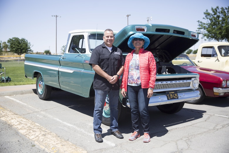 Lt. Col. Dennis Sanchez, commanding officer, Headquarters Battalion, stands with the General's Choice Award winner, Sue Duke and her husband Kenny Duke's 1965 Chevrolet C20 Pickup during the Twentynine Palms Car Show and Street Fair at Luckie Park in Twentynine Palms, Calif., April 16, 2016. (Official Marine Corps photo by Cpl. Julio McGraw/Released)