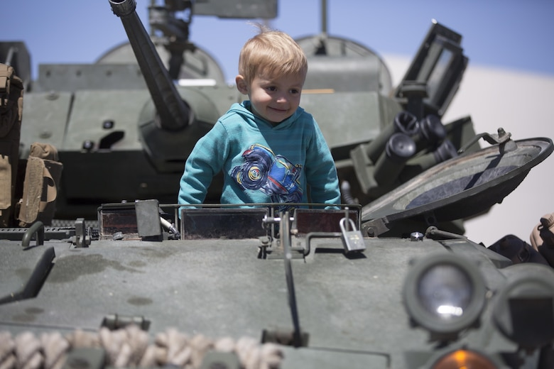 Matias Ryals, 2, son of Jacky and Devon Ryals, residents of Twentynine Palms, climbs out of the driver's seat of a Light Armored Reconnaissance Vehicle during the Twentynine Palms Car Show and Street Fair at Luckie Park in Twentynine Palms, Calif., April 16, 2016. (Official Marine Corps photo by Cpl. Julio McGraw/Released)