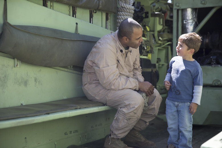 Gunnery Sgt. Elvin Pena, platoon sergeant, 3rd Assault Amphibian Battalion, talks to Skylar Joliffe,3, inside of an Amphibious Assault Vehicle during the Twentynine Palms Car Show and Street Fair at Luckie Park in Twentynine Palms, Calif., April 16, 2016. (Official Marine Corps photo by Cpl. Julio McGraw/Released)