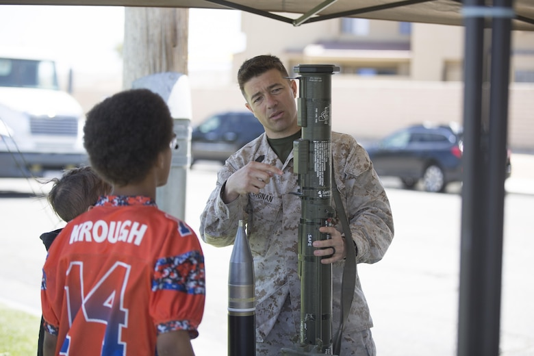 Master Sgt. David Dignan, operations chief, Explosive Ordnance Disposal, explains the different parts of a decommissioned M136 AT4 Anti-tank rocket during the Twentynine Palms Car Show and Street Fair at Luckie Park in Twentynine Palms, Calif., April 16, 2016. (Official Marine Corps photo by Cpl. Julio McGraw/Released)