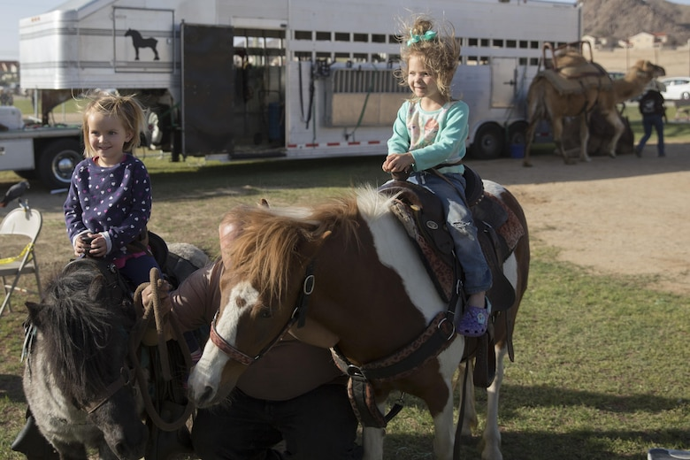 Combat Center children ride ponies during the Earth Day Extravaganza at Lincoln Military Housing Athletic Field April 15, 2016. (Official Marine Corps photo by Cpl. Connor Hancock/Released)