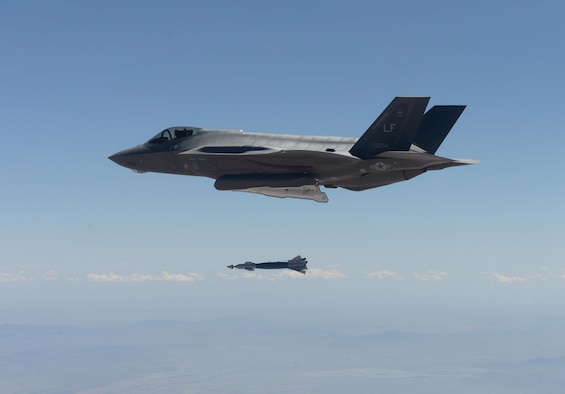 An F-35 Lightning II from the 61st Fighter Squadron deploys a GBU-12 500-pound laser- guided bomb for the first time in the squadron's history April 25, 2016, at the Barry M. Goldwater Range in Gila Bend, Ariz. Three F-35s successfully delivered six inert GBU-12s during the practice sortie, making the 61st FS the second squadron at Luke Air Force Base to drop bombs from the F-35. (U.S. Air Force photo by Airman 1st Class Ridge Shan)
