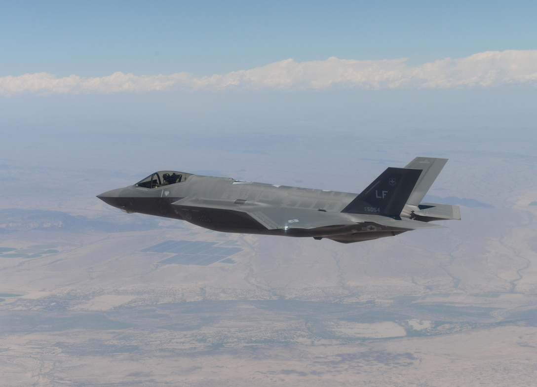 An F-35 Lightning II from the 61st Fighter Squadron lines up into an attack route in preparation to drop a GBU-12 500-pound laser-guided bomb, April 25, 2016, at the Barry M. Goldwater Range in Gila Bend, Ariz. Three F-35s successfully delivered six inert GBU-12s during the practice bombing, making the 61st FS the second squadron at Luke Air Force Base to drop bombs from the F-35. (U.S. Air Force photo by Airman 1st Class Ridge Shan)