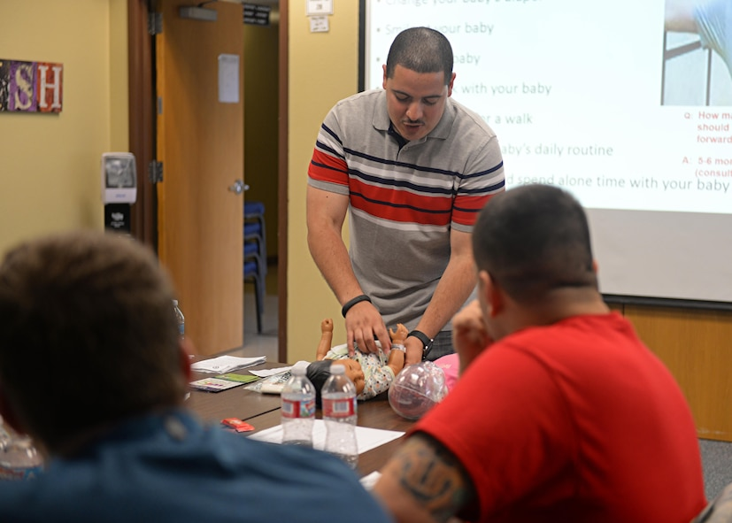 Staff Sgt. Daniel Mendez, 9th Reconnaissance Wing Equal Opportunity director and Dads 101 instructor, demonstrates how to properly change a baby during a Dads 101 class April 22, 2016, at Beale Air Force Base, California. The course is designed to assist all fathers; soon to be, new and multiple children fathers with pre and post-birth of their newborn. Some of the topics the course covers are diaper changing, handling newborns, building attachment and ways to assist their spouse. (U.S. Air Force photo by Senior Airman Ramon A. Adelan)
