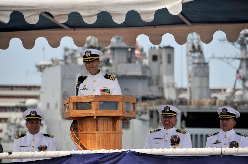 JOINT BASE PEARL HARBOR-HICKAM, Hawaii (July 31, 2014) Cmdr. Scott McGinnis addresses the crew of the Los Angeles-class fast attack submarine USS Houston (SSN 713) after relieving Cmdr. Paul Davis as commanding officer during a change of command ceremony.