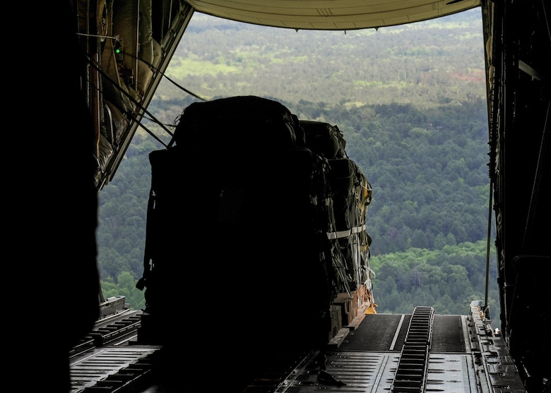 A Container Delivery System is offloaded from the back of a Royal Australian Air Force C-130J April 22, 2016, over Fort Polk, La. U.S. Air Force Airmen from Little Rock Air Force Base, Ark., worked alongside Australian Air Force Airmen during Exercise Green Flag 16-06, a large-scale, joint air mobility exercise. (U.S. Air Force photo/Senior Airman Harry Brexel)