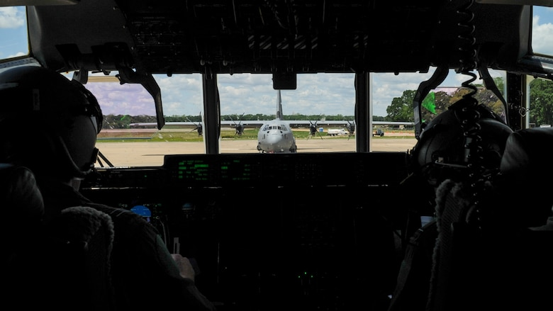 Royal Australian Air Force C-130J pilots prepare to takeoff after uploading a Humvee April 22, 2016, at an intermediate staging base in Alexandria, La. Several C-130s from four different nations converged at Little Rock Air Force Base, Ark., for Green Flag 16-06. (U.S. Air Force photo/ Senior Airman Harry Brexel)