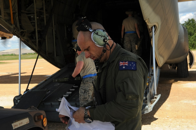 Royal Australian Air Force Warrant Officer Ryan Bowden, No. 37 Squadron C-130J loadmaster, reviews technical orders prior to loading a U.S. Air Force Humvee onto a C-130J April 22, 2016, at Fort Polk, La. The 34th Combat Training Squadron and U.S. Army Soldiers worked closely with coalition forces from Australia, New Zealand and Sweden during a Green Flag air mobility exercise April 14-24, 2016. (U.S. Air Force photo/Senior Airman Harry Brexel)