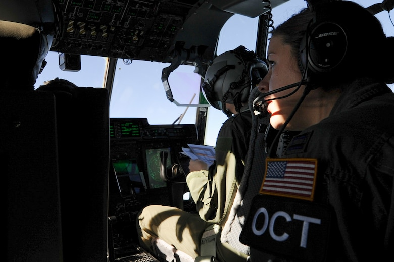 U.S. Air Force Capt. Kelsie Winklmann, a 34th Combat Training Squadron C-130H navigator instructor, acts as an Observer Coach Trainer for Royal Australian Air Force C-130J pilots during Green Flag 16-06 April 22, 2016, over Fort Polk, La. Rotational Green Flag exercises provide realistic, tactical-level joint combat employment training which is tailored to the specific needs of mobility Air Forces. (U.S. Air Force photo/Senior Airman Harry Brexel)