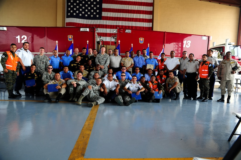 Members of the U.S. and Central American firefighting teams gather for a group photo during the CENTAM SMOKE (Sharing Mutual Operational Knowledge and Experience), a biannual event hosted by Joint Task Force-Bravo at Soto Cano Air Base, Honduras, April 22, 2016. Joint Task Force-Bravo has trained 866 firefighters from Guatemala, El Salvador, Honduras, Nicaragua, Costa Rica, Panama, and Belize since 2005, providing an opportunity for U.S. and Central American firefighters to work as one, building collaborative relationships as partner nations and allowing those involved to take valuable lessons back to their countries. (U.S. Army photo by Martin Chahin/Released)