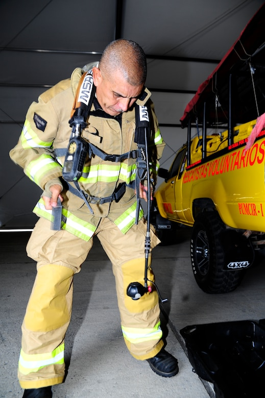 Herberth Gaekel, 612th Air Base Squadron fire inspector, prepares to conduct training for 34 firefighters from the seven countries of Central America during a CENTAM SMOKE (Sharing Mutual Operational Knowledge and Experience) exercise at Soto Cano Air Base, Honduras, April 20, 2016. The purpose of this exercise is to conduct joint training with cross-functional development between all participating countries, to aid and improve humanitarian and civic assistance operations, promoting regional cooperation that will improve collective capabilities and strengthen partnerships. (U.S. Army photo by Martin Chahin/Released)