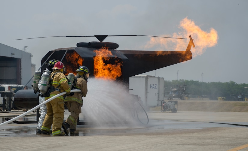 Firefighters from seven Central American nations participate in live-fire training, one of many exercises the 34 participants experienced during a week-long iteration of CENTAM SMOKE (Sharing Mutual Operational Knowledge and Experience) at Soto Cano Air Base, Honduras, April 20, 2016. Joint Task Force-Bravo has trained 866 firefighters from Guatemala, El Salvador, Honduras, Nicaragua, Costa Rica, Panama, and Belize since 2005, providing an opportunity for U.S. and Central American firefighters to work as one, building collaborative relationships as partner nations and allowing those involved to take valuable lessons back to their countries. Some Honduran firefighters who attended previous iterations of CENTAM SMOKE recently put what they learned to the test while fighting wildfires near Tela, Honduras. (U.S. Air Force Photo by Capt. David Liapis/Released)