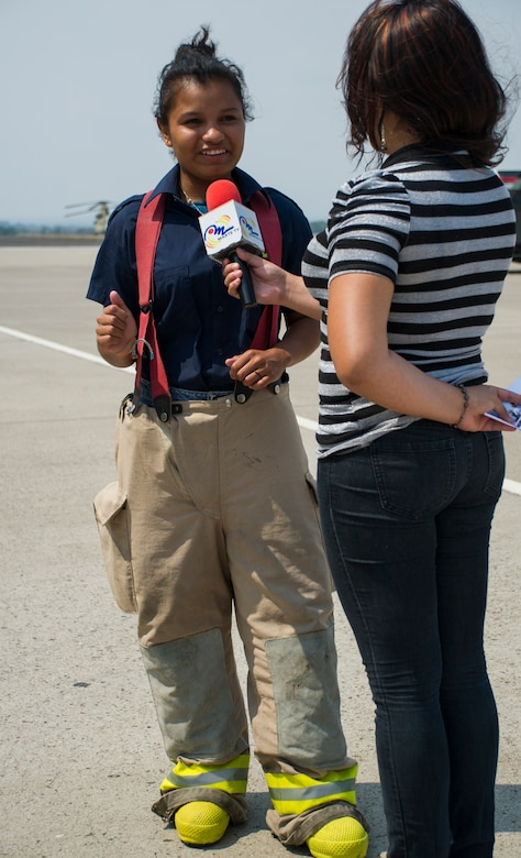 Nicaraguan firefighter Sofia Medina is interviewed by Erika Rivera, a journalist from Marte TV in Comayagua, Honduras, during a CENTAM SMOKE (Sharing Mutual Operational Knowledge and Experience) exercise at Soto Cano Air Base, Honduras, April 20, 2016. This iteration of CENTAM SMOKE included 34 firefighters participating in strenuous and challenging firefighting activities next to their U.S. counterparts. (U.S. Air Force Photo by Capt. David Liapis/Released)