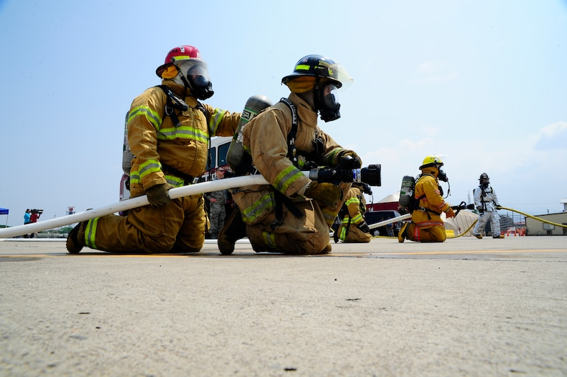 Firefighters from some of the seven Central American nations participate in live-fire training, one of many exercises the 34 participants experienced during a week-long iteration of CENTAM SMOKE (Sharing Mutual Operational Knowledge and Experience), at Soto Cano Air Base, Honduras, April 20, 2016. Joint Task Force-Bravo has trained 866 firefighters from across the region since 2005, providing an opportunity for U.S. and Central American firefighters to work as one, building collaborative relationships as partner nations and allowing those involved to take valuable lessons back to their countries. (U.S. Army photo by Martin Chahin/Released)