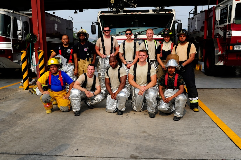 Members of the U.S. and Central American firefighting teams gather for a group photo after completing a relay race that tested their endurance and skills using firefighting equipment during CENTAM SMOKE (Sharing Mutual Operational Knowledge and Experience), a biannual event hosted by Joint Task Force-Bravo at Soto Cano Air Base, Honduras, April 19, 2016. During this iteration, the combined Central American team, comprised of fire crew member from Guatemala, El Salvador, Honduras, Nicaragua, Costa Rica, Panama and Belize, beat the U.S. team by a difference of four seconds. (U.S. Army photo by Martin Chahin/Released)