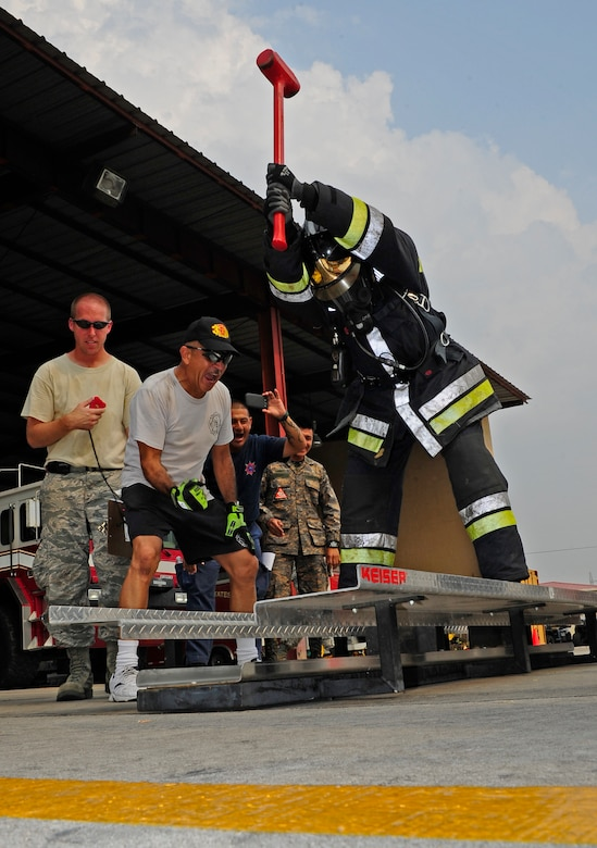 Honduran firefighter  Jorge Betanco strikes a Keiser Sled metal with a sledgehammer during a relay race against 612th Air Base Squadron fire crews during CENTAM SMOKE (Sharing Mutual Operational Knowledge and Experience), a biannual event hosted by Joint Task Force-Bravo at Soto Cano Air Base, Honduras, April 19, 2016. During this iteration, the combined Central American team beat the U.S. team. (U.S. Army photo by Martin Chahin/Released)