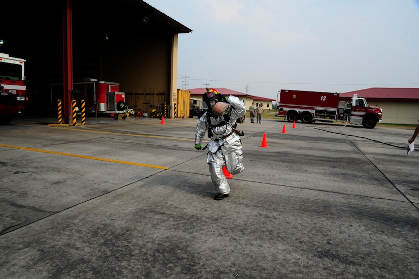 U.S. Air Force Staff Sgt Christopher Gonzales, 612th Air Base Squadron firefighter crew chief, demonstrates a proper hose carry to 34 firefighters from seven Central American countries during a CENTAM SMOKE (Sharing Mutual Operational Knowledge and Experience) exercise at Soto Cano Air Base, Honduras, April 19, 2016. The purpose of this exercise is to promote cross-functional development between all participating countries, to aid and improve humanitarian and civic assistance operations, promote regional cooperation that will improve collective capabilities, and strengthen partnerships. (U.S. Army photo by Martin Chahin/Released)