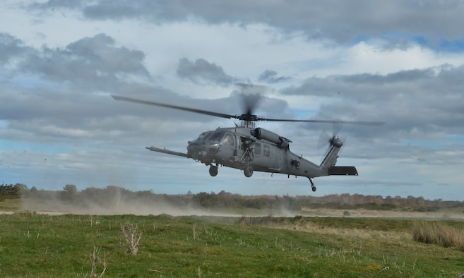 An HH-60G Pave Hawk takes-off after a simulated combat search and rescue exercise during Joint Warrior 2016 at Royal Air Force Tain, Scotland, April 20. The training for the 56th Rescue Squadron will not only provide insight from its coalition counter parts, but will prepare the squadron for future taskings downrange. (U.S. Air Force photo/Senior Airman Nigel Sandridge)