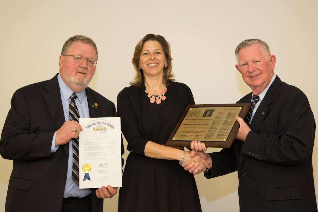 Mr. Warren Brown (left) and Mr. Lyle Lockwood present AFRL Biological Materials Researcher Dr. Wendy Goodson with the Outstanding Engineers and Scientists Award at the 57th Annual Affiliate Societies Council Banquet and Awards Ceremony on April 21, 2016.  (Photo courtesy of Affiliate Societies Council/Jim Solomon)