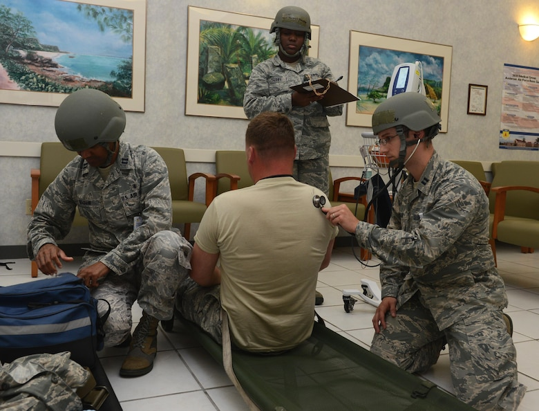 Airmen with the 36th Medical Group simulate responding to a casualty during Operational Readiness Exercise Sling Stone 16-03 April 19, 2016, at Andersen Air Force Base, Guam. The Airmen assessed the casualty's airway and checked his pulse. (U.S. Air Force photo by Airman 1st Class Arielle Vasquez/Released)