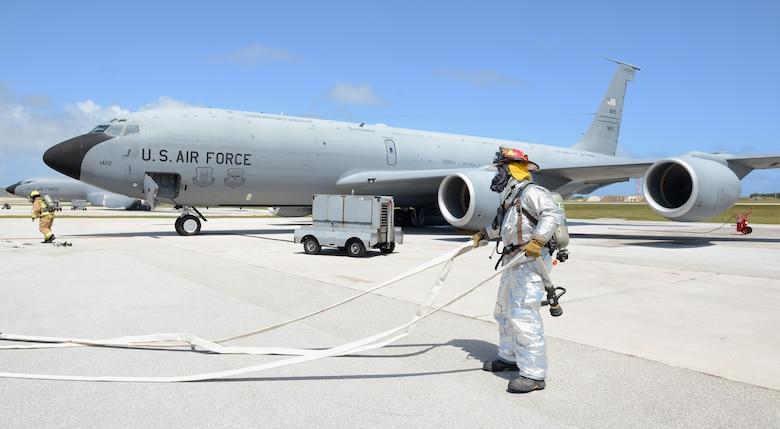 36th Civil Engineer Squadron firefighters pull hoses to combat a simulated fire on the flightline during an operational readiness exercise April 20, 2016, at Andersen Air Force Base, Guam. The scenario was part of a four-day ORE which tested the wing's preparedness for wartime scenarios. (U.S. Air Force photo by Airman 1st Class Arielle Vasquez/Released)