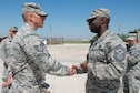 U.S. Air Force Chief Master Sgt. Vegas Clark, 39th Air Base Wing command chief, coins U.S. Air Force Tech. Sgt. Travis Hoff, 39th Civil Engineer Squadron heavy repair section chief, April 25, 2016, at Incirlik Air Base, Turkey. Clark recognized Hoff for his performance while serving as a fitness assessment cell augmentee. Hoff responded to a collapsed runner during the Air Force physical fitness test and provided first-response actions, ensuring the well-being of the member. (U.S. Air Force photo by Senior Airman John Nieves Camacho/Released)