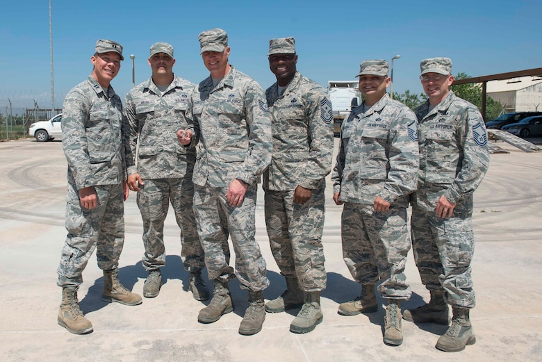 U.S. Air Force Chief Master Sgt. Vegas Clark, 39th Air Base Wing command chief, stands with 39th Civil Engineer Squadron Airmen, April 25, 2016, at Incirlik Air Base, Turkey. Clark met with the 39th CES quality assurance flight to view and learn more about the tasks they accomplish. (U.S. Air Force photo by Senior Airman John Nieves Camacho/Released)
