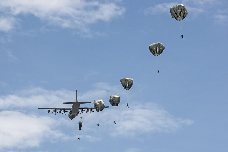 U.S. Air Force Airmen from the 820th Base Defense Group glide through the air during a memorial jump ceremony, April 21, 2016, at Henry Tift Myers Airport, Tifton, Ga. The Airmen jumped in memory of Tech. Sgt. Lee Fulp who lost his life in a motorcycle accident, July 11, 2015. (U.S. Air Force photo by Airman 1st Class Janiqua P. Robinson/Released)