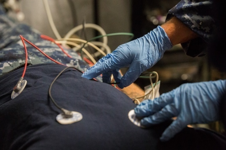 A sailor with 2nd Medical Battalion applies electrodes to monitor a patient's vitals during Health Service Augmentation Program training at Camp Lejeune, N.C., April 20, 2016. HSAP training, a week long exercise, trains medical personnel the basics of a shock trauma platoon and how it operates in a deployed environment.