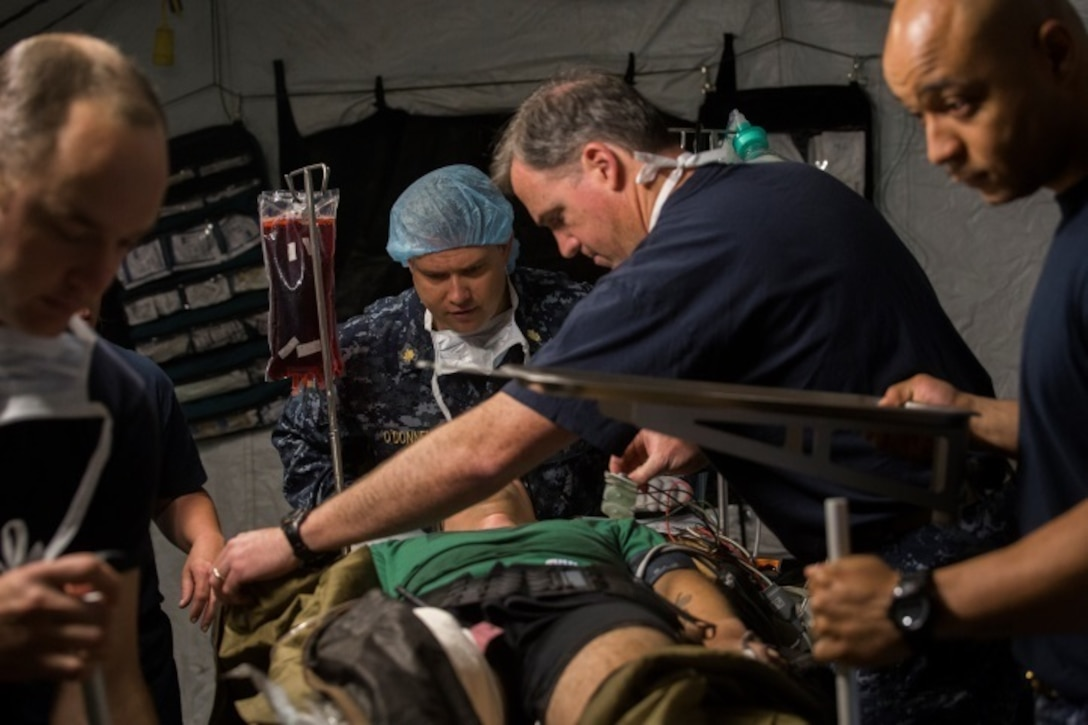 Sailors with 2nd Medical Battalion prepare a simulated trauma victim for surgery during Health Service Augmentation Program training at Camp Lejeune, N.C., April 22, 2016. Sailors attached to the Camp Lejeune Naval Hospital underwent a week-long training exercise that familiarized them with the gear and operations of a shock trauma platoon in a deployed environment