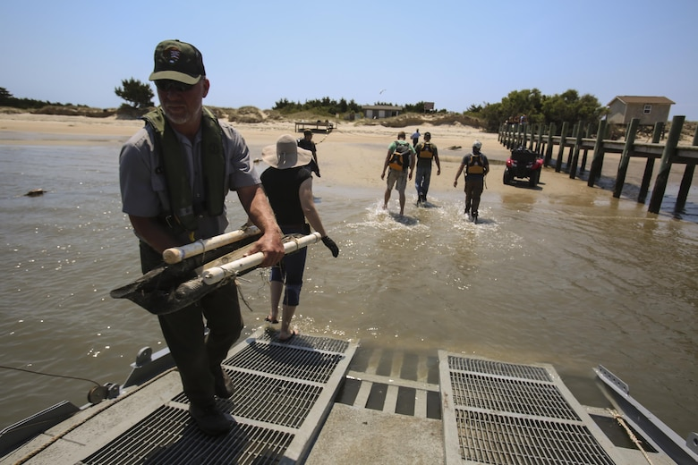Marines from 2nd Radio Battalion and 2nd Law Enforcement Battalion worked in cooperation with the National Park service to clean up debris from Shackleford Banks Island on April 21, 2016. The pollution comes to the island from the ocean due to hurricanes and littering; the goal is to clean the island biannually to reduce the risk of it affecting the wildlife and the wild horses inhabiting the island. (U.S. Marine Corps photo by Lance Cpl. Miranda Faughn/Released)