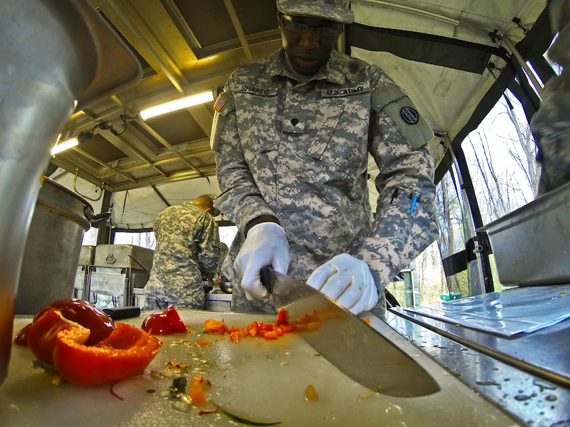 Spc. Jordan Sharpe, a food service specialist with the 733rd Transportation Company, slices a red pepper during the annual Philip A. Connelly Award competition at Fort Indiantown Gap, Pa., April 23, 2016. (U.S. Army photo by Staff Sgt. Dalton Smith / Released)