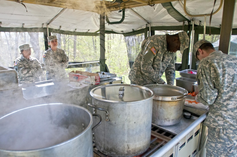 Food service specialists, of the 733rd Transportation Company, prepare lunch, while being graded by the U.S. Army Reserve food advisors, during the annual Philip A. Connelly Award competition at Fort Indiantown Gap, Pa., April 23, 2016. (U.S. Army photo by Staff Sgt. Dalton Smith / Released)