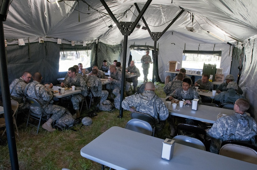 Soldiers with the 733rd Transportation Company, based out of Reading, Pa., eat the meal prepared by the food service specialists of the 733rd T.C. during the annual Philip A. Connelly Award competition at Fort Indiantown Gap, Pa., April 23, 2016. (U.S. Army photo by Staff Sgt. Dalton Smith / Released)