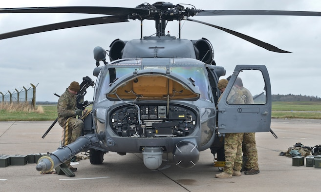 Crew members perform a preflight inspection on a 56th Rescue Squadron HH-60G Pave Hawk during Joint Warrior 2016 at Royal Air Force Lossiemouth, Scotland, April 15, 2016. Joint Warrior is a three-week multination event catered to enhancing the capabilities of its personnel for real-world events through various forms of training, including air-to-ground combat. (U.S. Air Force photo/Senior Airman Nigel Sandridge)
