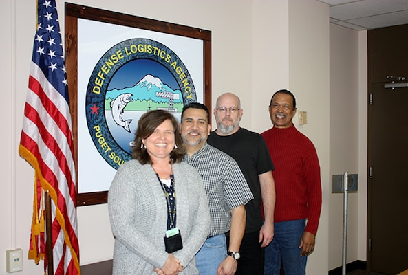 The DELTA Trident Project Material Support Team (l-r) Lisa Benning, Raul Davila, John Slocum, Benny Myers, all part of DLA Maritime Puget Sound. Their hard work ensures timely material is provided to maintain Ohio-class submarines while in-port for maintenance.