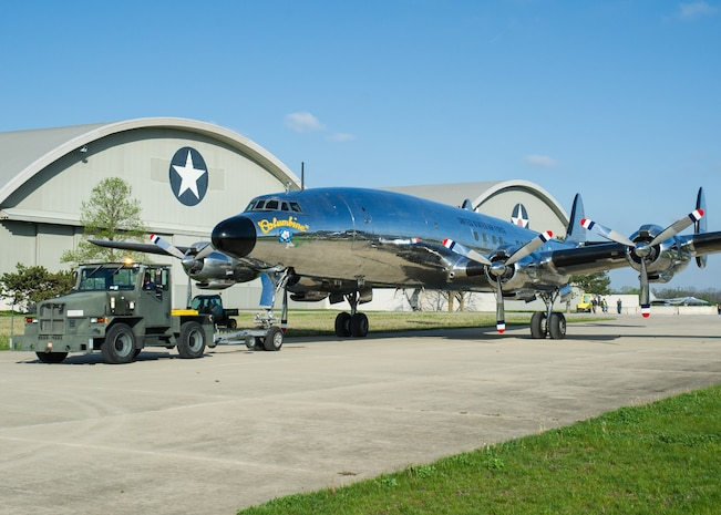 """DAYTON, Ohio -- The Lockheed VC-121E """"Columbine III"""" being towed to the fourth building at the National Museum of the United States Air Force on April 23, 2016. This aircraft is one of ten Presidential aircraft in the collection. (U.S. Air Force photo by Ken LaRock)"""