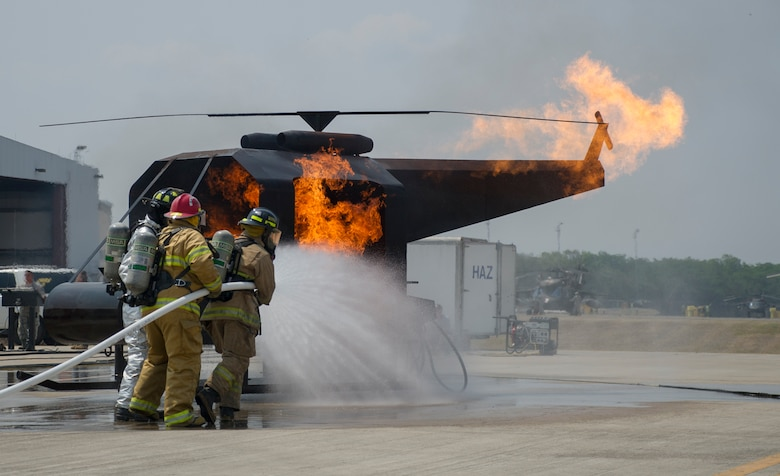 Firefighters participate in live-fire training during a weeklong exercise at Soto Cano Air Base, Honduras, April 20, 2016. Joint Task Force-Bravo hosted firefighters from Belize, Guatemala, El Salvador, Honduras, Nicaragua, Costa Rica, and Panama for the Central America Sharing Mutual Operational Knowledge and Experience exercise April 18-22. (U.S. Air Force photo/Capt. David Liapis)