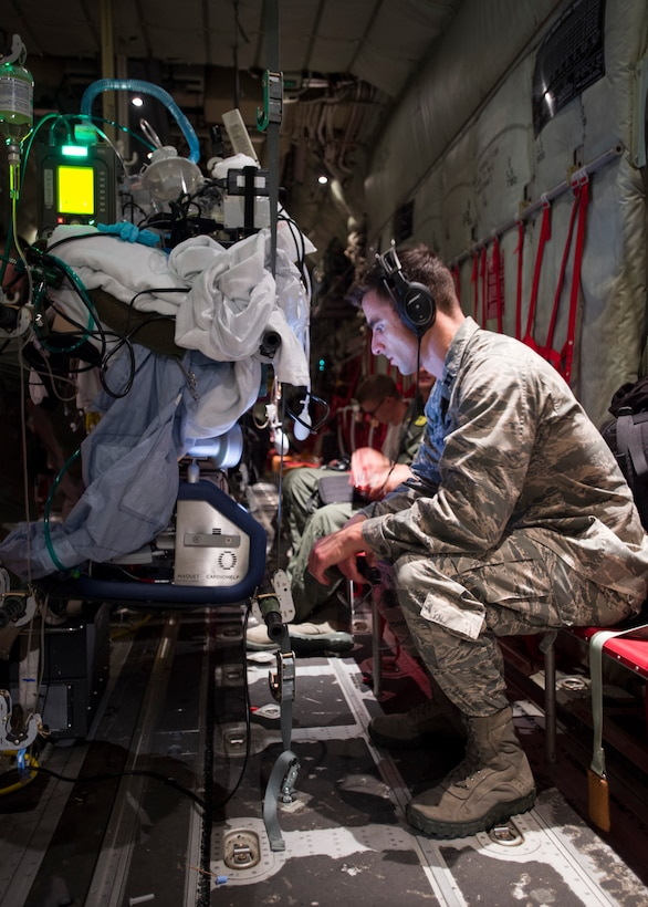 Capt. Jeffrey Dellavolpe, 959th Medical Operations Squadron critical care physician, regulates the Extracorporeal Membrane Oxygenation system during a flight to San Antonio Military Medical Center, Joint Base San Antonio-Fort Sam Houston, Texas, April 20. ECMO is a heart-lung bypass system that circulates blood through an external artificial lung and sends it back into the patient's bloodstream. (U.S. Air Force photo/Staff Sgt. Kevin Iinuma)
