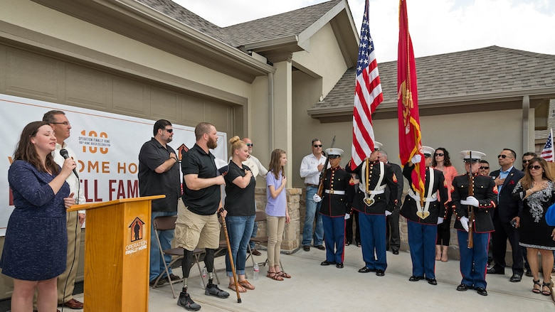 Alyssa Beach sings the national anthem at Cpl. Jonathan Dowdell's dedication ceremony in League City, Texas, April 14, 2016. The home dedication marks Operation FINALLY HOME's 100th dedication for a deserving veteran or surviving spouse.