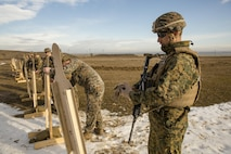 U.S. Marines with Black Sea Rotational Force review their shot groups as they zero their individual weapon during a live-fire exercise aboard Mihail Kognalniceanu Air Base, Romania, Feb. 2, 2016. Marines from 1st Battalion, 8th Marine Regiment, conducted battle sight zeroes on various individual weapons systems, to prepare for future BSRF exercises and contingencies. (U.S. Marine Corps photo by Cpl. Kelly L. Street, 2D MARDIV COMCAM/Released)