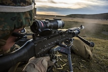 A U.S. Marine with Black Sea Rotational Force fires an M240B light machine gun during a live-fire exercise to confirm its zero aboard Mihail Kognalniceanu Air Base, Romania, Feb. 2, 2016. Marines from 1st Battalion, 8th Marine Regiment, conducted battle sight zeroes on various individual weapons systems, to prepare for future BSRF exercises and contingencies. (U.S. Marine Corps photo by Cpl. Kelly L. Street, 2D MARDIV COMCAM/Released)