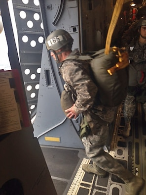Lt. Col. John Robinson, 315th Operations Group deputy commander, jumps out of a Joint Base Charleston C-17 Globemaster III over Fryar Drop Zone at Fort Benning, Georgia when he attended the Army's Basic Airborne Course. For 15 years Robinson has been on the other end of the C-17 dropping Soldiers for the BAC, this time it was his brothers in the 701st Airlift Squadron were at the controls. (Courtesy photo)