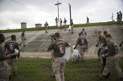 "Marines with Marine Corps Support Facility New Orleans, Marine Forces Reserve remove litter along the levee in New Orleans, Louisiana on Earth Day, April 22, 2016, after a volunteer event run by the Single Marines Program. Each year, the program hosts a ""Day in Service,"" in which Marines and sailors dedicate their day to volunteering in their local community."